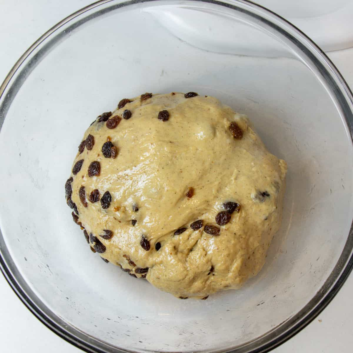 Dough in a glass bowl before proofing.