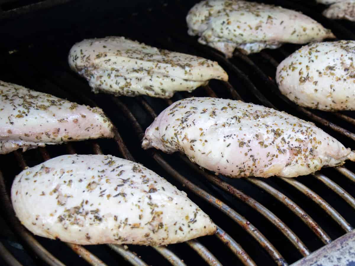 Grilling chicken breasts, ready to be flipped.