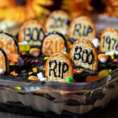 A dessert made with chocolate pudding, brownies and halloween candy.