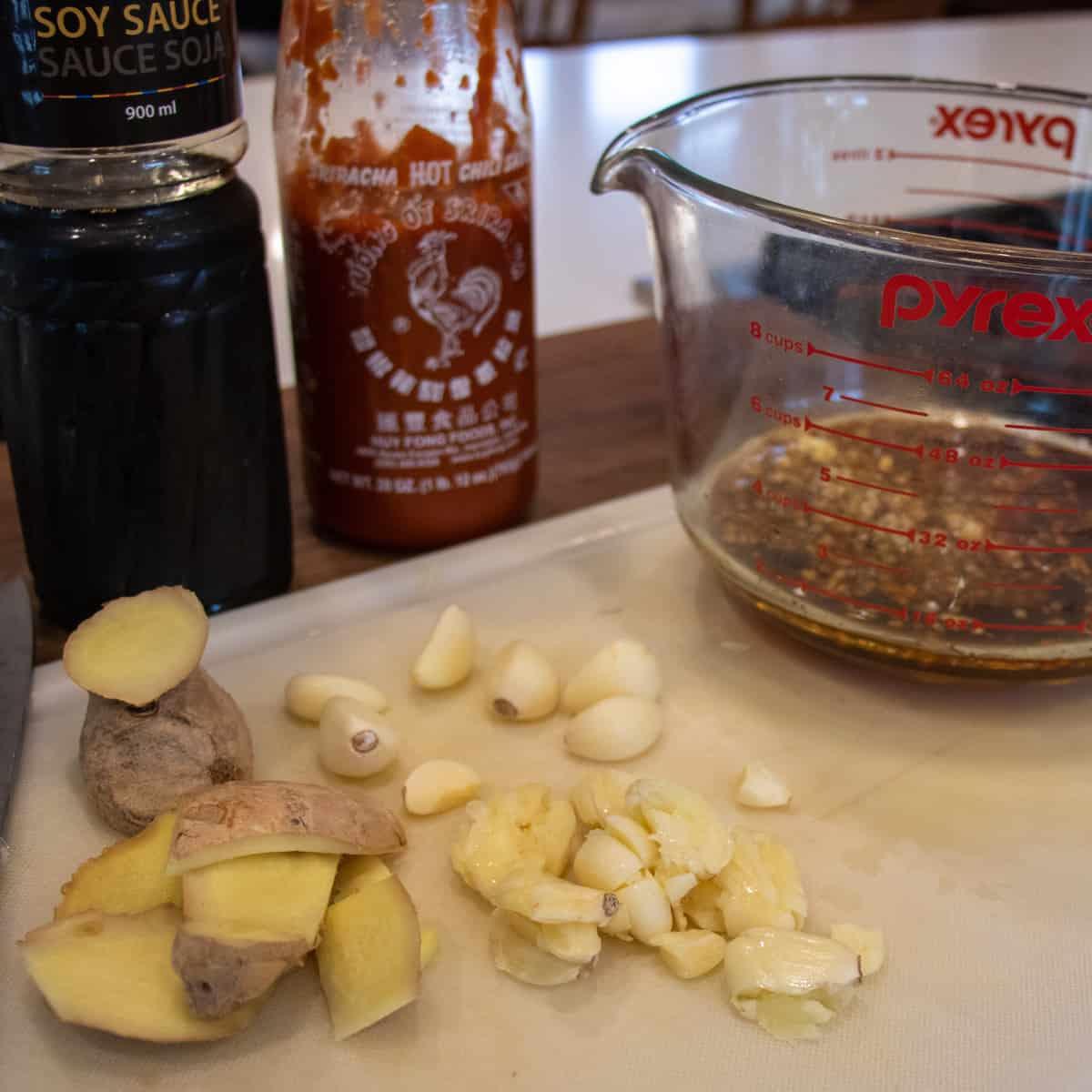 Fresh ginger and garlic on a cutting board