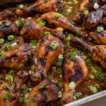 Baked chicken drumsticks in a baking pan